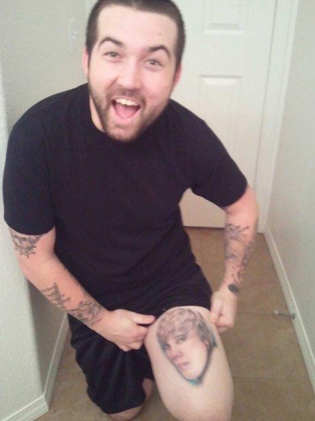 man with justin bieber tattoo