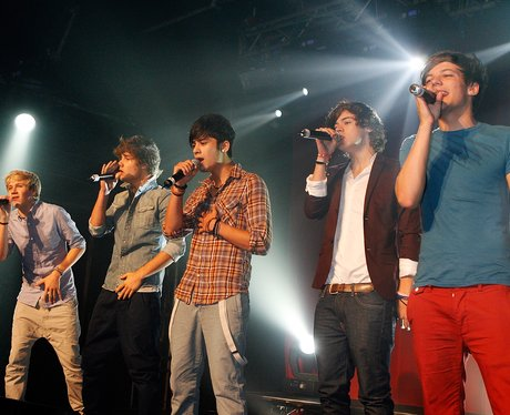 One Direction perform live on stage