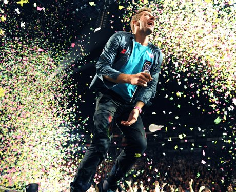 Chris Martin from Coldplay performing on stage in Cologne in Germany