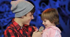 Justin performs 'baby' with his little sister