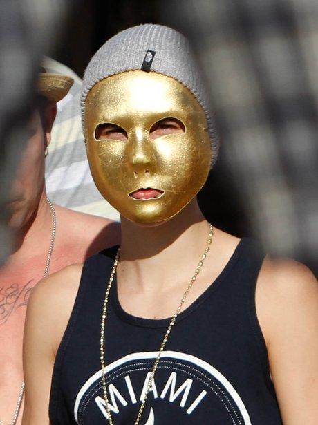 pop star wears a gold mask