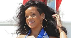 Rihanna wears a maxi dress on holiday.
