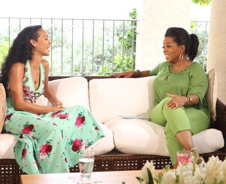 Rihanna with Oprah Winfrey wearing a floral dress
