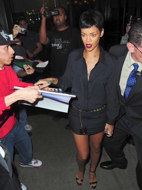 Rihanna wearing a black mini skirt in New York.