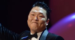 Psy presents his award for the best video during t