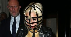 Lady Gaga wearing a cage mask