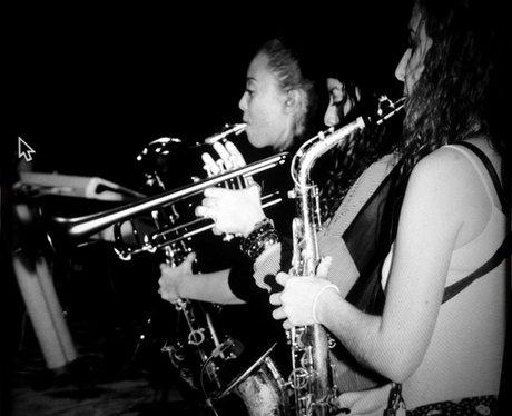 Beyonce playing a saxaphone
