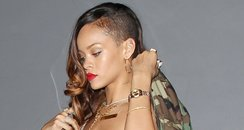 Rihanna wearing a tight red mini dress