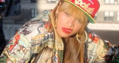 beyonce in a hat