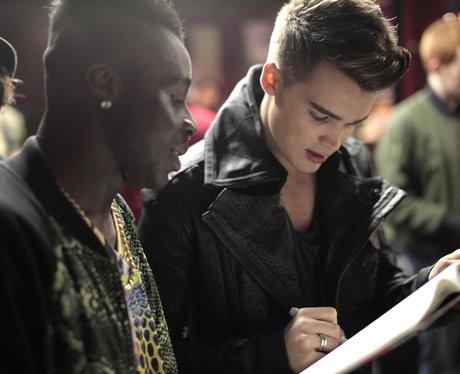 Union J's Josh signing an autograph