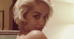 Rita Ora shows off her new tattoo