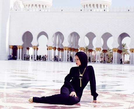 Rihanna poses outside a mosque
