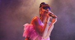 Lily Allen performing on stage