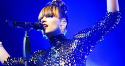 Lily Allen performs in a catsuit