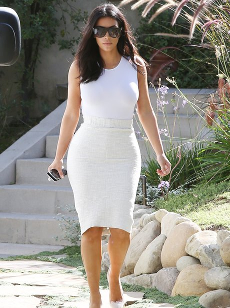 Kim Kardashian wearing a tight white dress