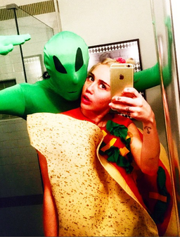 Miley Cyrus dresses as a taco
