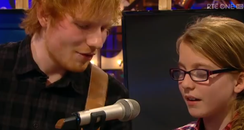 Ed Sheeran singing with young fan video still