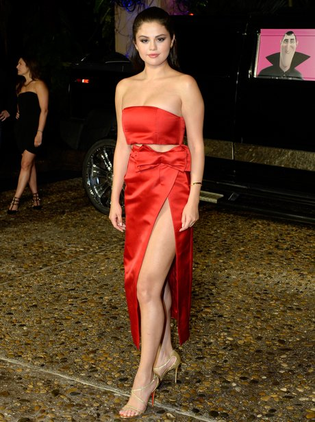 Lady in red selena gomez rocks a daring thigh split and latest