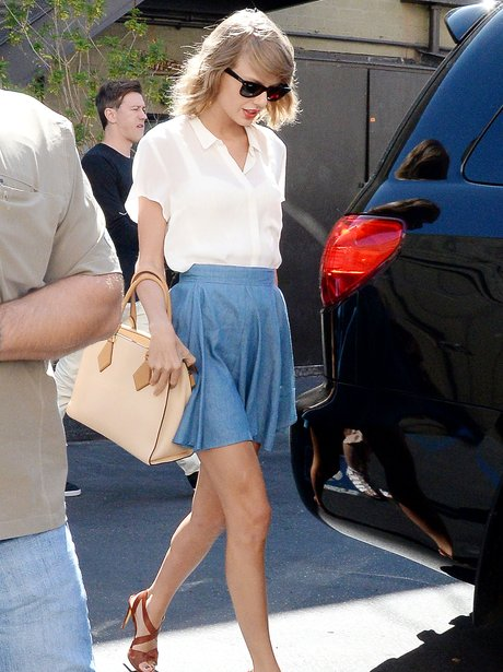 Taylor Swift in a denim skirt